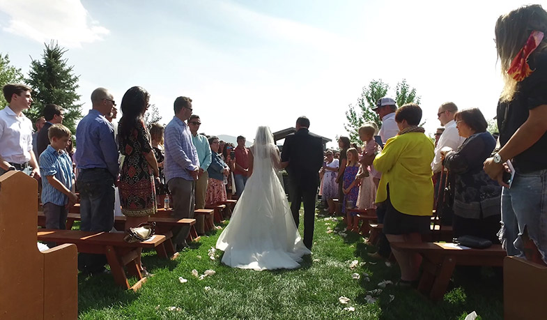 Wedding video captured as father and daughter walk down the aisle.